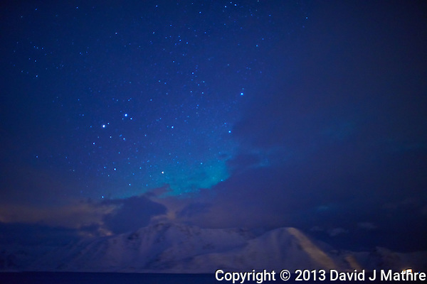 Early Morning (04:22 AM) Glimmer of Northern Lights While Sailing North on the Hurtigruten MV Nordkapp. Image taken with a Nikon D800 and 24 mm f/1.4G lens (ISO 1600, 24 mm, f/1.4, 4 sec). (David J Mathre)
