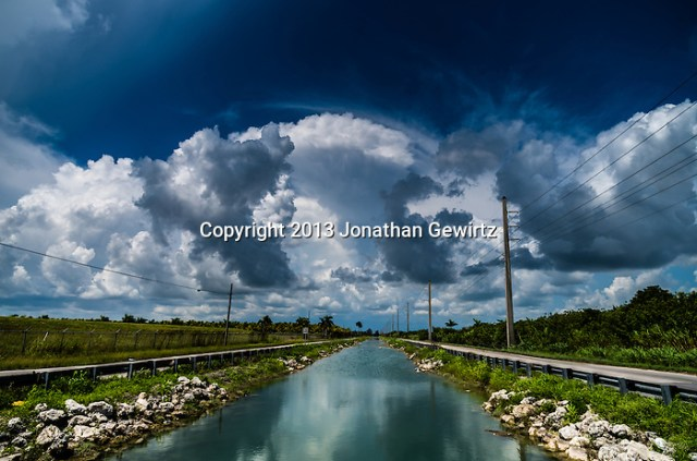 Billowing storm clouds provide a dramatic backdrop to the landscape around the canal along Coconut Palm Drive (SW 248th Street) near Homestead, Florida. (Jonathan.Gewirtz@gmail.com)