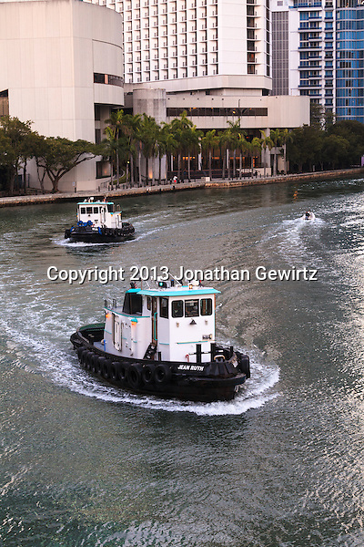 Two tugs cruise west on the Miami River near 3rd Avenue in downtown Miami, Florida (Jonathan Gewirtz   jonathan@gewirtz.net)