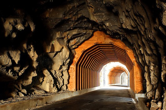 Trail running through the Mosier Twin Tunnels, Mosier, Oregon, USA (Brad Mitchell)