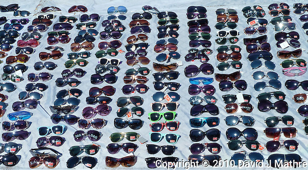 Sunglasses for sale on the street along Laguna de los Coipos in Buenos Aries. Images taken with a Leica V-Lux 20 camera (ISO 80, 6.9 mm, f/5.6, 1/800 sec) (David J Mathre)