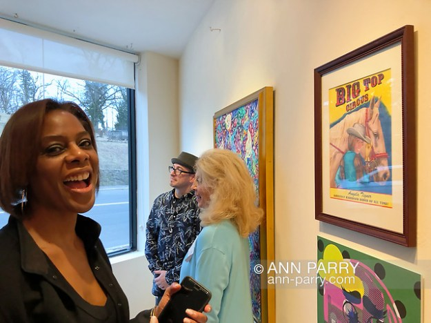 Huntington, NY, USA. March 29, 2019. Angela Tigner is across from Bareback Rider at Huntington Arts Council Reception for Lowbrow Art Exhibition. Tigner was the model for Bob Stuhmer's illustration.