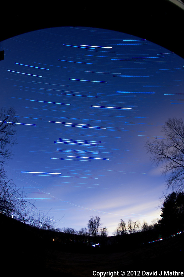 Winter Sky Star and Jet Trails. Image taken with a Nikon D700 and 16 mm f/2.8 fisheye lens (ISO 200, f/2.8, 300 sec). Composite of 16 images processed with Startrails program. (David J. Mathre)
