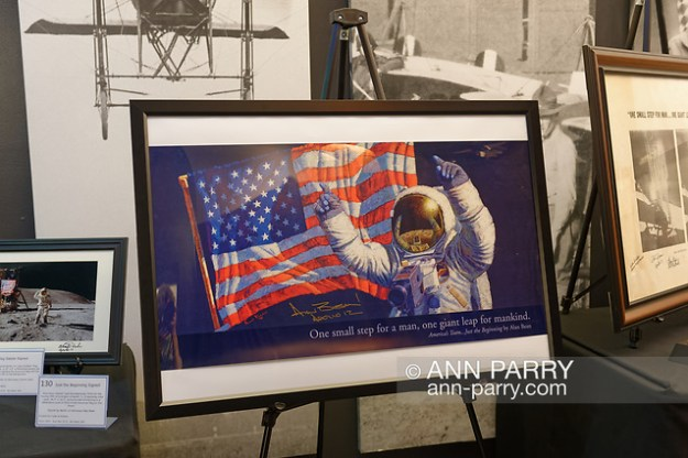 Garden City, New York, U.S. June 6, 2019. Colorful print'Just the Beginning' of Neil Armstrong in front of American Flag - signed by its artist Apollo 12 astronaut Alan Bean - is a Silent Auction fundraiser space memorabilia item on display at Cradle of Aviation Museum during Apollo at 50 Anniversary Dinner, an Apollo astronaut tribute celebrating the Apollo 11 mission Moon landing. (Ann Parry/Ann Parry, ann-parry.com)