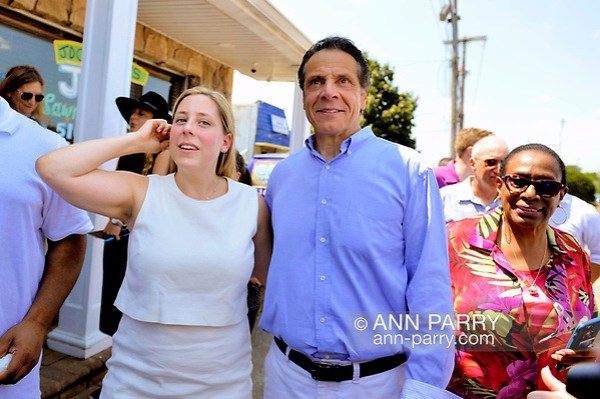 Massapequa, NY, USA. August 5, 2018. L-R, LIUBA GRECHEN SHIRLEY, Congressional candidate for NY 2nd District, and Gov. ANDREW CUOMO walk with supporters during opening of joint campaign office for Grechen Shirley and NY Sen. J. Brooks. (© 2018 Ann Parry/Ann-Parry.com)
