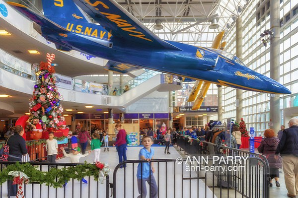 Garden City, New York, USA. November 24, 2018. The Festival of Trees, an annual family fun holiday event at the Cradle of Aviation Museum, has a free ice skating rink in the atrium. All proceeds raised - including from sale of donated decorated Christmas trees - benefit the non-profit charity Cerebral Palsy Association of Nassau County, Inc., of Long Island.(© 2018 Ann Parry/Ann-Parry.com)