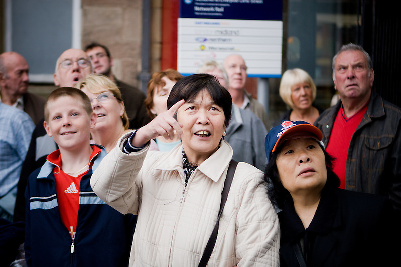 Liverpool wakes up to find a giant spider has appeared on the side of Concourse House by Lime Street Station. The expressions on peoples faces are priceless.  Wonder, confusion and curiosity. (Pete Carr)