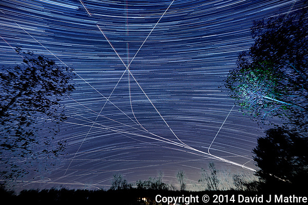 Star and jet trails looking south from my backyard. Composite of 161 images taken with a Nkon D800 camera and 14-24 mm f/2.8 lens (ISO 100, 14 mm, f/4, 30 sec). (David J Mathre)