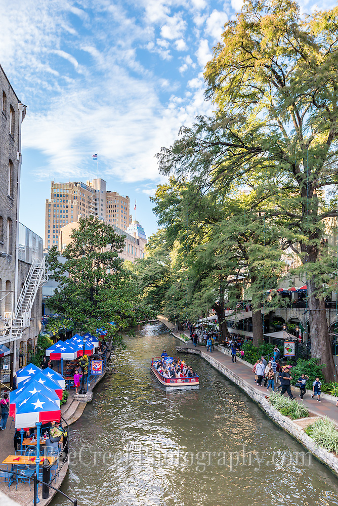 It was such a nice day along the river walk in San Antonio, you can see the river boat full of tourist and people walking and out having a meal at one of the many fine restaurants on this beautiful day with a great sky and good clouds. (Tod Grubbs & Cynthia Hestand)
