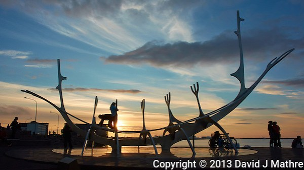 Silhouette of Sun Voyager (Sólfar) at Sunset. Image taken with a Nikon 1 V2 camera and 10 mm f/2.8 lens (ISO 160, 10 mm, f/8, 1/400 sec). Nikonians Photo Adventure with Mike Hagen. (David J Mathre)