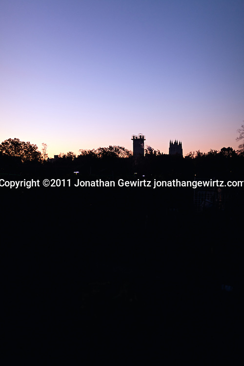 Silhouette of the two towers of the National Cathedral in Washington, DC at dawn. Scaffolding on one of the towers is for repairs following the earthquake of August 23, 2011. (Copyright 2011 Jonathan Gewirtz jonathan@gewirtz.net)