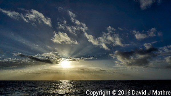 Morning sun, crepuscular rays, and clouds after breakfast from the aft deck of the MV World Odyssey. Leica T camera and 11-23 mm lens (ISO 100, 11 mm, f/14, 1/1000 sec). (David J Mathre)