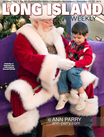 Cover Page Photo by Ann Parry; Long Island Weekly published by Anton News. Nov. 21, 2012 - Garden City, New York, U.S. - Santa Claus gets a visit from PATRICK HERR, 3 1/2, from Hempstead, at Roosevelt Field shopping mall in Long Island. Mom JULIANA CARREON and ISMAEL CARREON took him to visit the jolly man. (Cover photo © 2013 Ann Parry; Long Island Weekly published by Anton News)