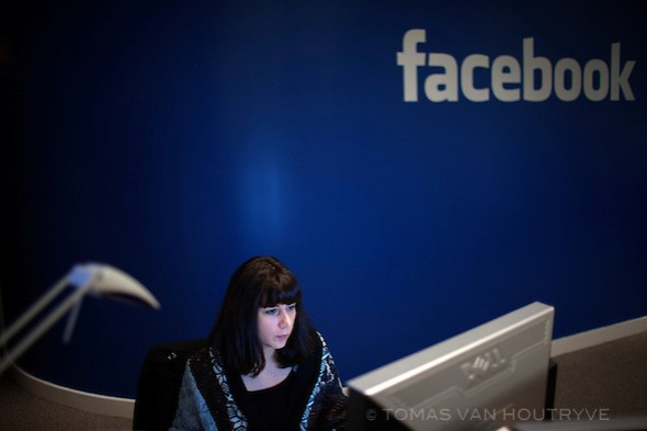 An employees works at a computer inside the offices of Facebook in Paris, France on Nov. 29, 2010. (Tomas van Houtryve / VII Network)