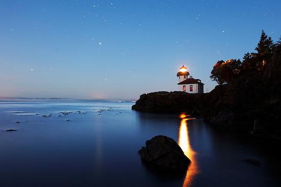 Lime Kiln Lighthouse stands watch over Haro Strait under a starry sky, Washington (Brad Mitchell)