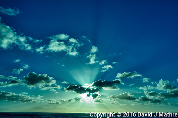 Morning sun and clouds with Crepuscular rays (God's rays) from the deck of the MV World Odyssey while traveling across the Pacific Ocean. Image taken with a Leica T camera and 23 mm f/2 lens (ISO 100, 23 mm, f/14, 1/500 sec). Raw image processed with Capture One Pro. (David J Mathre)