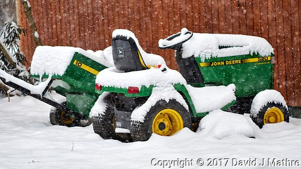 Lawn tractor parked in the snow. Our second snowstorm in two days. Winter has finally arrived. Fuji X-T1 camera and 90mm f/2 lens (ISO 200, 90 mm, f/2, 1/300 sec). (David J Mathre)
