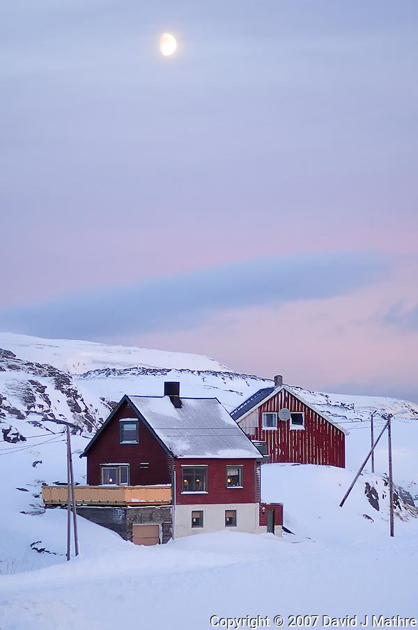 Moon at Dawn Over Havøysund Norway. Image taken with a Nikon D2xs and 85 mm f/1.4D lens (ISO 200, 85 mm, f/1.4, 1/180 sec). (David J. Mathre)