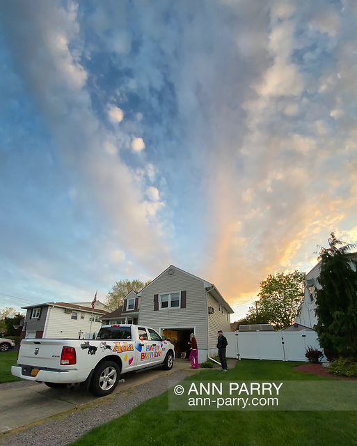 Seaford, New York, U.S. May 5, 2020. At dusk, L-R, JOEY CESTARE and LAURIE GRAB are by truck decorated for friend Ada Cea's birthday. (© 2020 Ann Parry/AnnParry.com)