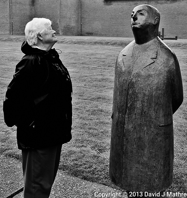 Mother posing with the ´Monsieur Jacques´ (1956) sculpture by Oswald Wenckebach in the Kröller-Müller museum and sculpture garden.  Hoge Veluwe National Park in Otterlo, Netherlands. Image taken with a Nikon 1 V2 camera and 6.7-13 mm VR lens (ISO 250, 13 mm, f/5.6, 1/100 sec). Converted to B&W with Capture One Pro 7. (David J Mathre)