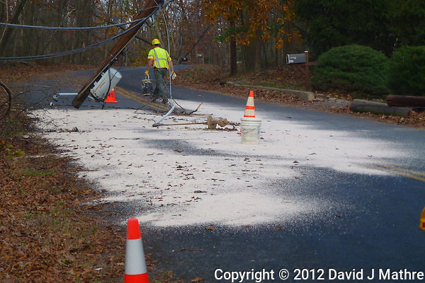 Transformer Oil Cleanup. Hurricane Sandy Aftermath in Skillman New Jersey Day 4. Image taken with a Leica V-Lux 30 camera. (David J Mathre)