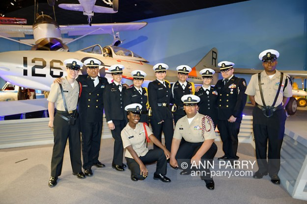 Garden City, New York, U.S. June 6, 2019. Freeport High School Navy Junior ROTC cadets wearing uniforms and about to participate at Apollo at 50 Anniversary Dinner at Cradle of Aviation Museum, pose for photo in front of historic aircraft at museum exhibit. (© 2019 Ann Parry/Ann-Parry.com)