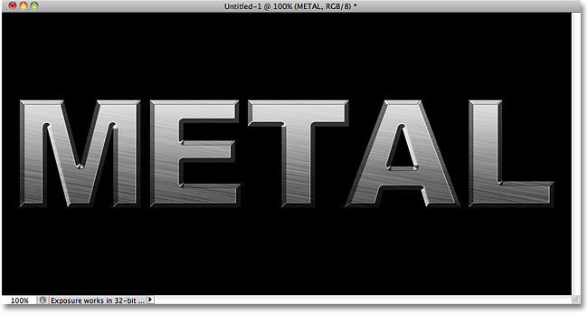 The metal text effect after applying the layer styles. Image © 2010 Photoshop Essentials.com.