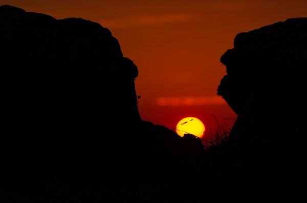 Cycladic sunset.  Armenisti lighthouse, Mykonos, Cyclades, Greece