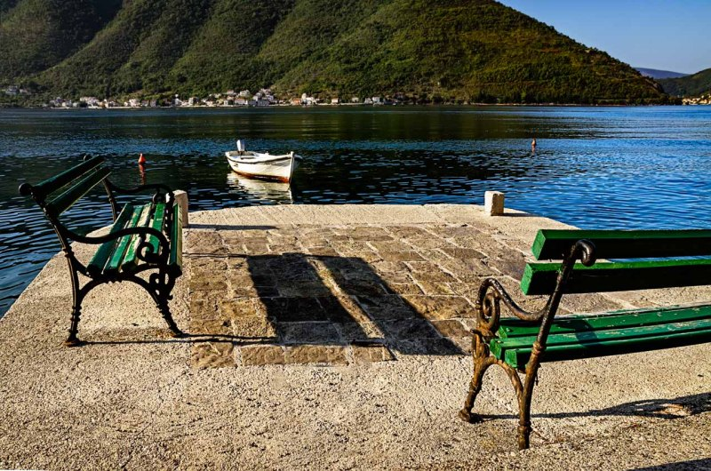 Benches close to the water edge in Perast