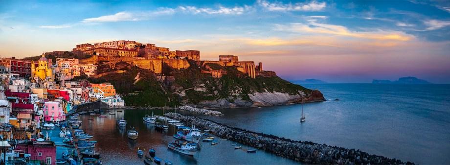 Discover Procida, Italian capital of culture for 2022Procida al tramonto con vista su Marina della Corricella e Terra Murata