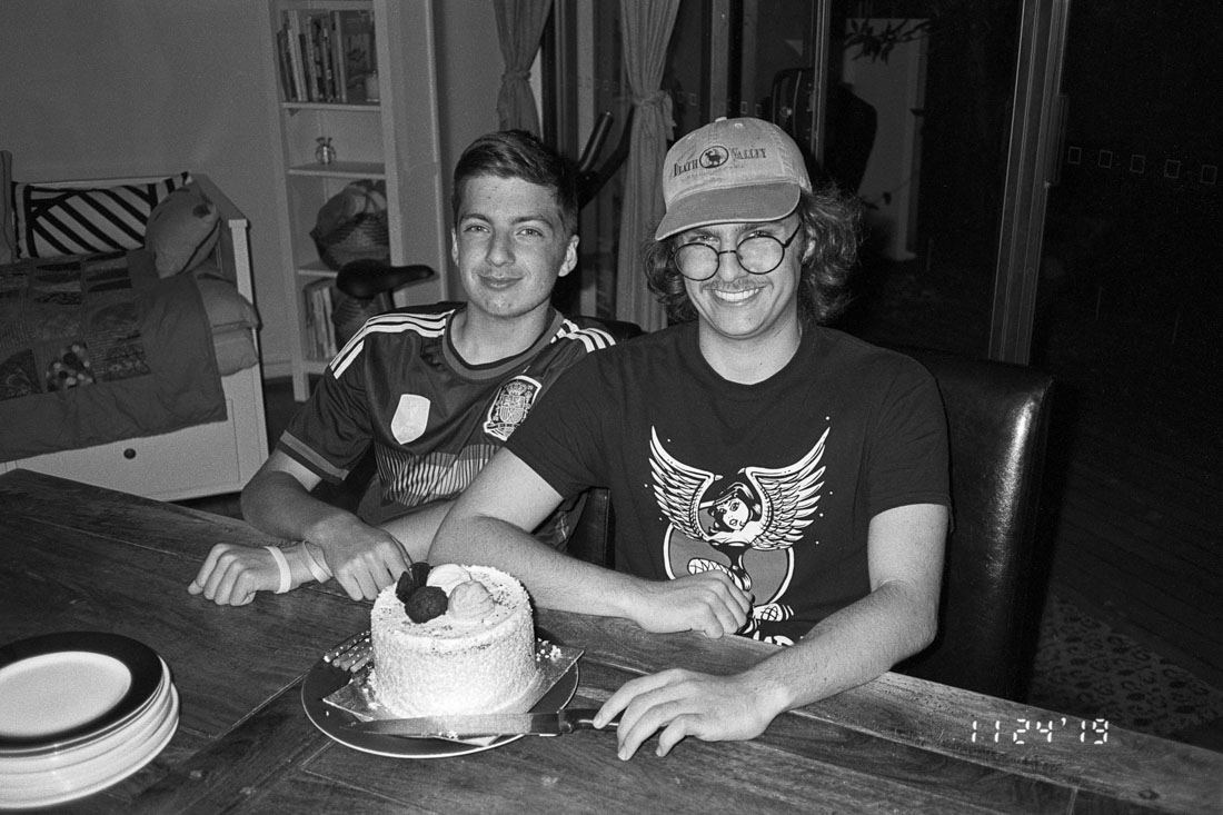 Matt and Alec with a cake | Nikon RD2 | Ilford FP4 Plus