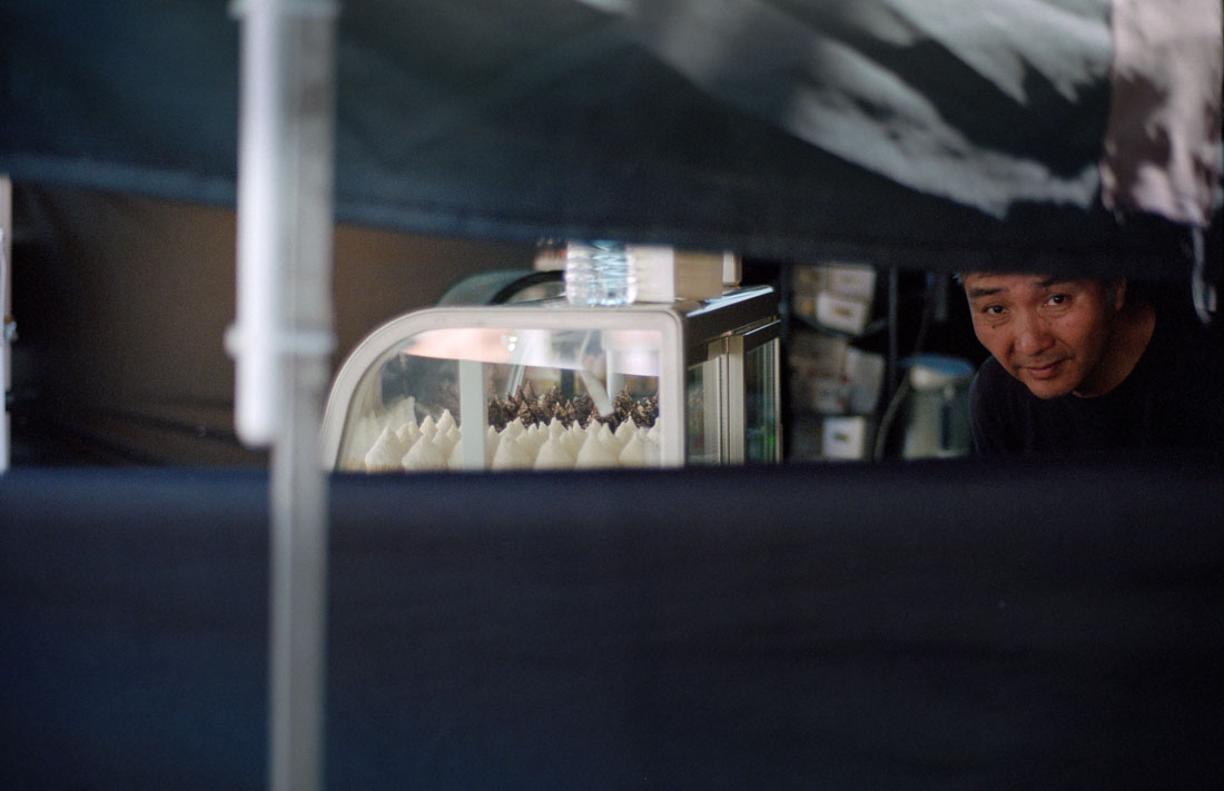 Peeking from within the bakery tent |Nikon F3 | Nikkor 50mm f/1.8 AF | Kodak Portra 400