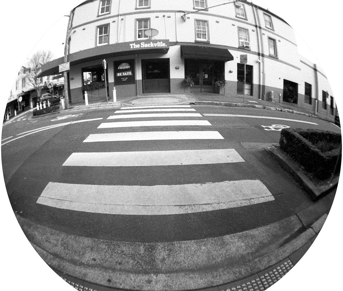 Crossing outside the Sackville | Lomography Fisheye 2 | Ilford HP5 Plus