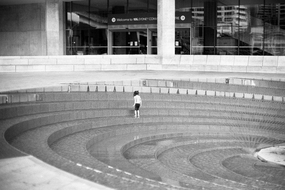 Girl in fountain | Pentax Spotmatic SP | Pentax Super-Takumar 50mm f/1.4 | Ilford FP4 Plus