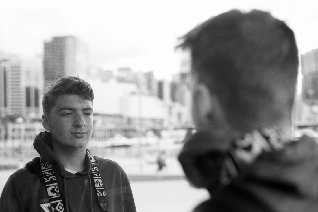 Alec looking into an outdoor mirror | Pentax Spotmatic SP | Pentax Super-Takumar 50mm f/1.4 | Ilford FP4 Plus
