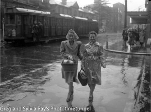 Women on the corner of Hunter and Bolton Streets, Newcastle, on a rainy day, circa 1940s.