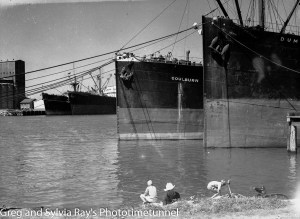 "Boys fishing near ships tied at the ""dolphins"", Newcastle Harbour, January 20, 1949."