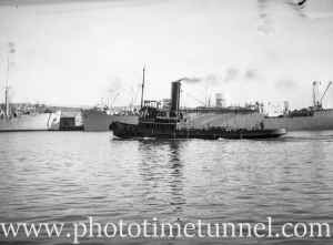 Tug and shipping in Newcastle Harbour, NSW, circa 1946. (1)
