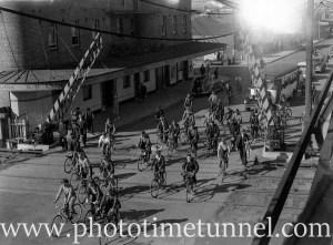 Cyclists at the Beaumont Street railway gates, Hamilton, Newcastle, NSW, January 19, 1941. (1)