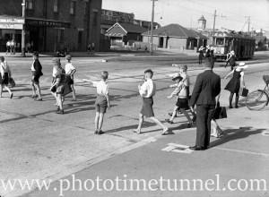 Children crossing Tudor Street Hamilton, Newcastle, NSW, March 28, 1939.