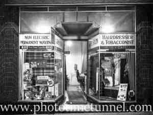 Window display and interior glimpse of V. Bailey's hairdressing salon and tobacconist shop. Sydney, NSW. Circa 1920.