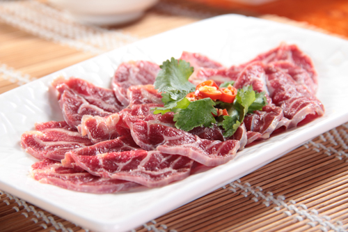 a dish of beef Hind Shank for hot pot photo