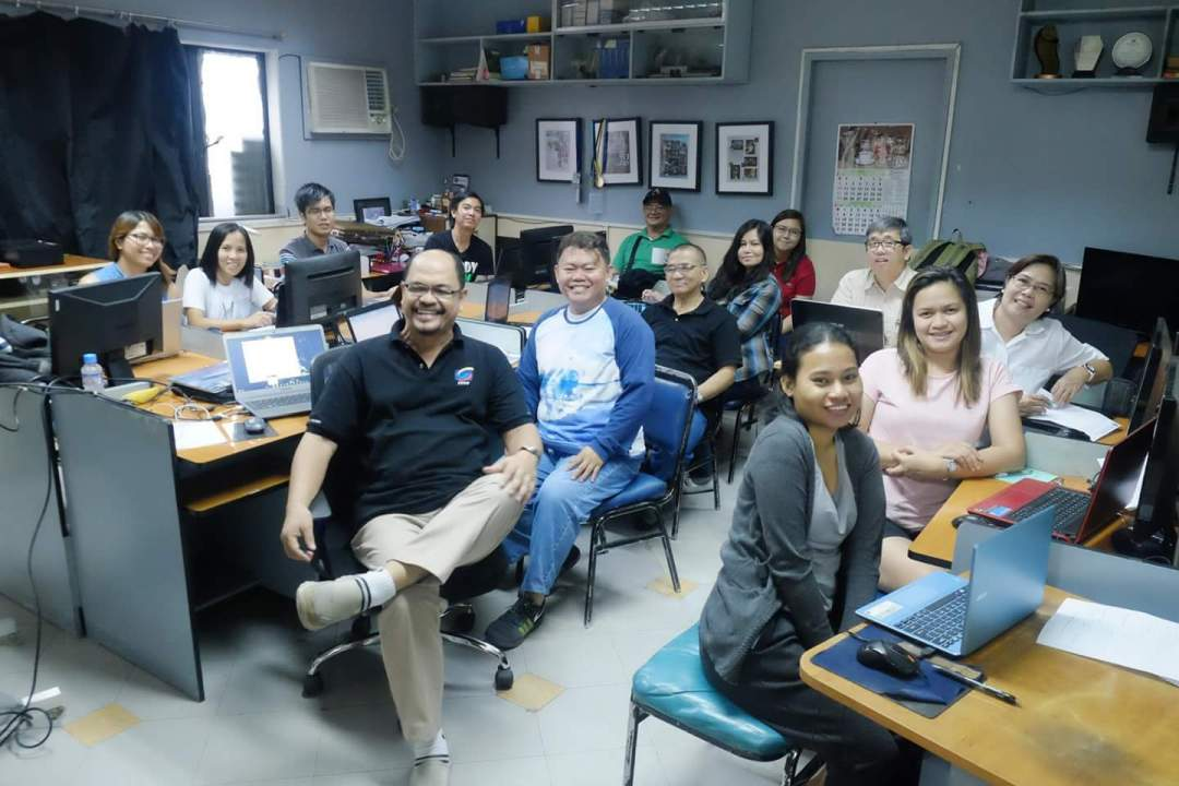 A Lightroom class at the FPPF Digital Darkroom, with instructor Chris Malinao at center.