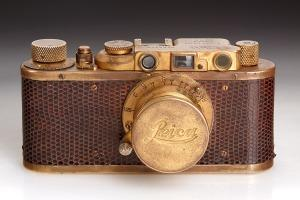 "Leica II Mod.D Luxus: This gold-plated Leica model D with brown waran reptile body-cover is the last Leica 'Luxus' ever produced, in absolutely original condition. With matching gold-plated 5cm Elmar f/3.5 lens no. 144963 and gold-plated cap. The camera was delivered as ""Lykup Luxus"" in 1932, October 27 to BAKI & FILS in Tirana, Albania."