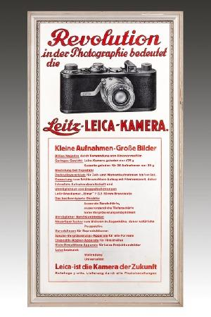 "Leitz - Leica Advertisement: The title of this picture reads ""Revolution in photography means Leitz-LEICA-CAMERA, Small Photographs – Great Pictures"". The advertising panel must have been produced after October 1925, when the Elmar was introduced."
