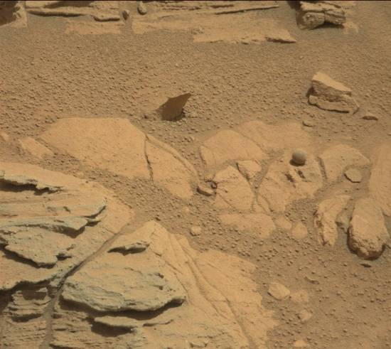 """Mastcam captured a Martian """"ball"""" surrounded by a myriad of tiny spheres. This image was taken by Mastcam: Right (MAST_RIGHT) onboard NASA's Mars rover Curiosity on Sol 746 (2014-09-11 14:46:58 UTC). Image Credit: NASA/JPL-Caltech/MSSS."""