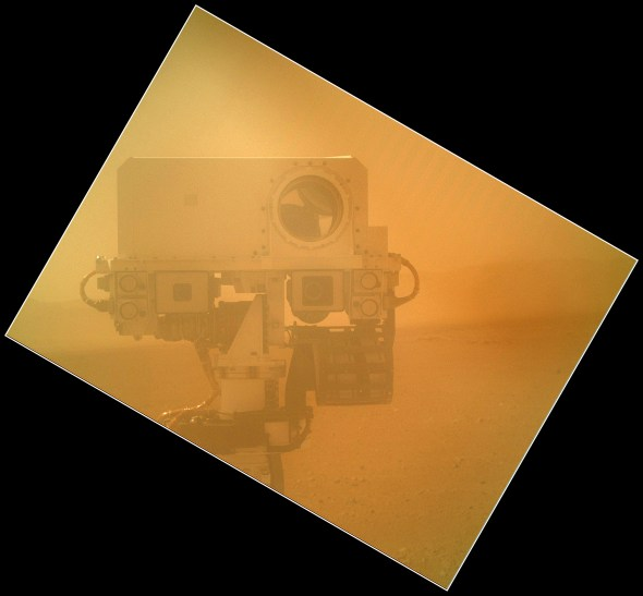 """""""Rover Takes Self Portrait On Sol 32 (Sept. 7, 2012). The image shows the top of Curiosity's Remote Sensing Mast including the ChemCam, two Mast cameras and four Navigation cameras. The angle of the frame reflects the position of the MAHLI camera on the arm when the image was taken. The image was acquired while MAHLI's clear dust cover was closed. The image was taken on a day when MAHLI and other instruments and tools on the turret were being inspected using the rover's Mastcams and Navcams. The MAHLI cover was in the closed position in order to inspect the dust cover to ensure that the cover, its hinge, and the volume it sweeps when it opens are clear of debris."""" Image Credit: NASA/JPL-Caltech/Malin Space Science Systems."""