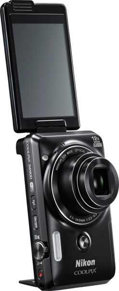 Nikon COOLPIX S6900, black, with a 3-inch Vari-angle touch screen, built-in kickstand and front shutter release button.