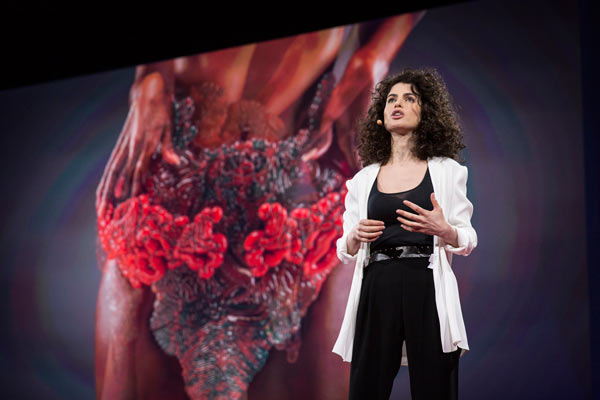 Neri Oxman's lauded TED Talk reveals Stratasys 3D printed wearable designed to host living matter in another world's first. Photo credit: Bret Hartman, courtesy of TED.