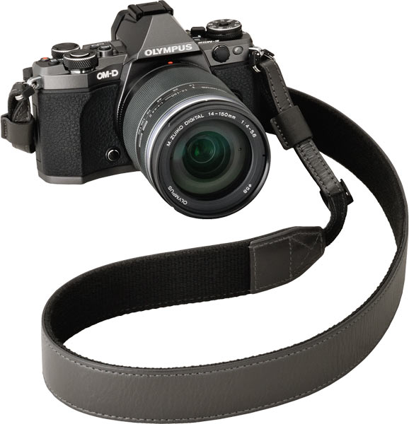 OM-D E-M5 Mark II in the special titanium body color + M.ZUIKO DIGITAL ED 14-150mm f4.0-5.6 II* lens + specially-crafted leather strap